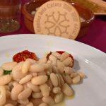 Sardina curada en tomates de penjar i fesols